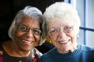 Deserving care photo - elderly A.A. and white women together