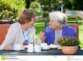 Deserving Care photo - two elderly woman enjoying lunch together